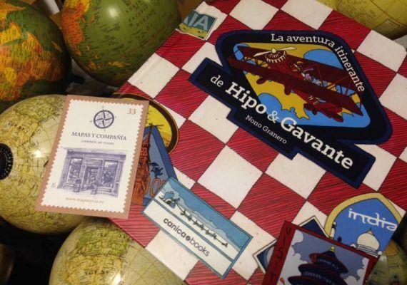 Presentación de libro y pintar el escaparate de Mapas y Compañía